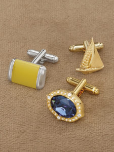 three gold and yellow style cufflinks